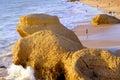 Tourists enjoying the evening sun on praia da gale beach algarve portugal october Stock Photography
