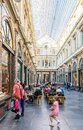 A tourists family is going window-shopping in the Saint-Hubert Royal Galleries in Brussels, Belgium Royalty Free Stock Photo