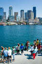 Tourists on ferry approaching seattle take photos of the skyline as the approaches the city a beautiful sunny summer day Stock Photo