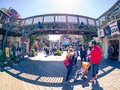 Tourists on Fisherman`s Wharf, Pier 39 under wooden bridge Royalty Free Stock Photo