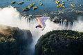 Tourists fly over the Victoria Falls on the trikes. Royalty Free Stock Photo
