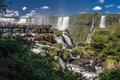 Tourists in foz do iguassu park on a pier looking the powerful waterfalls the iguacu parana brazil Royalty Free Stock Photo