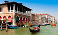 Tourists on gondola in Venice, Italy Royalty Free Stock Photo