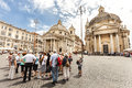 Tourists group with tour guide in rome italy piazza del popolo traveling of peoples square a crowd of stops the famous square Royalty Free Stock Photo