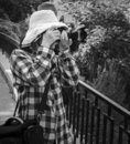 Tourists in hats photographing local landmarks