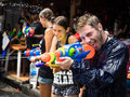 Tourists having fun celebrating songkran in bangkok thailand shooting water and on khao san road the traditional thai new year Stock Images