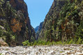 Tourists hike in Samaria Gorge in central Crete, Greece. The national park is a UNESCO Biosp