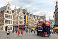 Tourists in a horsecar downtown in the medieval city Antwerp Royalty Free Stock Photo