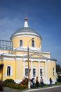 Tourists in kolomna kremlin people walk on the territory of moscow region russia an old yellow orthodox church is seen at Stock Photography