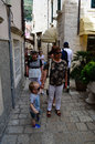 Tourists in little tipical street in the old town of dubrovnik eating pankekase sin croatia Stock Image