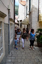 Tourists in little tipical street in the old town of dubrovnik tourist croatia Stock Photos