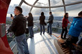 Tourists in the London eye cabin Stock Image