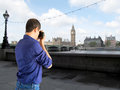 Tourists in london photographing big ben icon Royalty Free Stock Photos