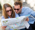 Tourists looking at a map Royalty Free Stock Photos