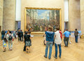 Tourists in louvre museum visitors admire paintings paris france Stock Photography