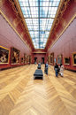 Tourists in louvre museum which is located paris france Royalty Free Stock Photography