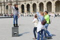 Tourists at louvre paris apr enjoy and take photos france Royalty Free Stock Photo