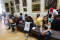 Tourists at louvre paris apr enjoy watching the paintings france Royalty Free Stock Image