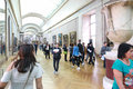 Tourists at louvre paris apr enjoy watching the paintings france Royalty Free Stock Photos