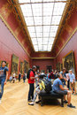 Tourists at louvre paris enjoy watching the paintings france Royalty Free Stock Photos
