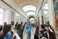 Tourists at louvre paris enjoy watching the paintings france Stock Photos