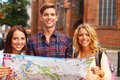 Tourists with map three friends tourist outdoors Royalty Free Stock Photo