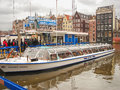Tourists on a mooring of pleasure boats in amsterdam netherla the netherlands february netherlands Royalty Free Stock Photography