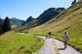 Tourists on mountain track walking in french alps haute savoie Royalty Free Stock Photos