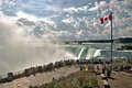 Tourists at niagara horseshoe falls gather to view the from the table rock welcome center part of the in ontario canada Royalty Free Stock Image
