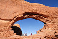 Tourists at north window arch in arches national park on march near moab utah Royalty Free Stock Photos