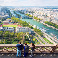 Tourists are on the observation deck of the eiffel tower in pari paris is one major tourist attractions Stock Images