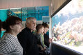 Tourists at an oceanarium portrait of the Royalty Free Stock Photo