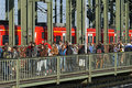 Tourists padlocks and train on hohenzollern bridg germany state land north rhine westphalia city cologne köln the Royalty Free Stock Image