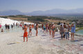 Tourists in pamukkale many standing by some hills turkey Royalty Free Stock Image