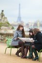Tourists paris looking map planning their trip Royalty Free Stock Photo