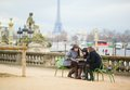 Tourists in paris planning their trip using map Royalty Free Stock Photography
