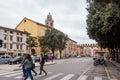 Tourists pass Corso Porta Nuova in Verona