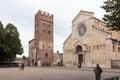 Tourists and passersby walk near Basilica di San Zeno Maggiore