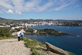 Tourists on the path to cadaques tourist couple standing a overlooking spanish coastal town of Royalty Free Stock Photography