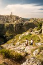 Tourists on the paths on the hill in front of the Sassi of Mater Royalty Free Stock Photo