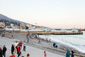 Tourists on pebble beach of yalta city in evening russia september is resort the north coast the black sea Stock Images