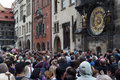 Tourists in prague observe the procession of the clock the old town square Stock Image