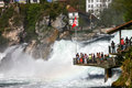 Tourists at rheinfall switzerland schaffhausen apr observation deck on april th in schaffhausen is the biggest waterfall Stock Photo