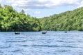 Tourists ride on pleasure boats on Lake Kazyak, in the national park Plitvice Lakes. Royalty Free Stock Photo