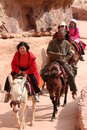 Tourists riding donkey in Petra Jordan Royalty Free Stock Images