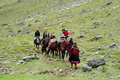 Tourists riding horse in Peru green mountain valley Royalty Free Stock Photo