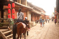 Tourists riding a horse in shuhe ancient town lijiang china march traveler walking around is fun and happy on march is the old Stock Photo