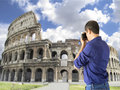 Tourists in rome photographing colosseum icon roma Stock Photography