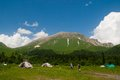 Tourists at the shelter fischt view of mountain oshten russia north caucasus Royalty Free Stock Photo