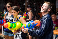 Tourists Shooting Water Guns at Songkran Festival in Bangkok, Th Royalty Free Stock Photo